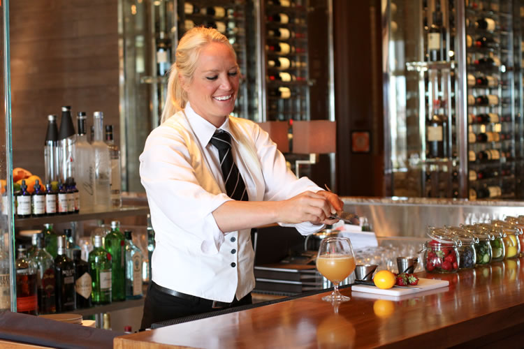 Jenny Buchhagen, lead mixologist at The St. Regis Monarch Beach, is inspired by Stonehill Tavern as she crafts bespoke culinary cocktails. (Photo by Jody Tiongco)