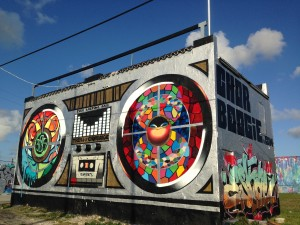 "Street artists Oscar ""Trek6"" Montes and Chor Boogie transformed an abandoned building into a boom box to attract passersby on Interstate 95 to the Wynwood Art District. 